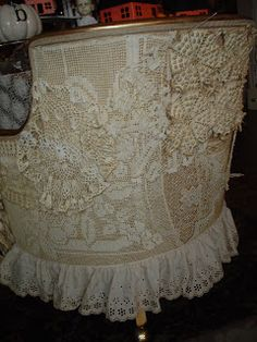 Lace and doily chair covering.