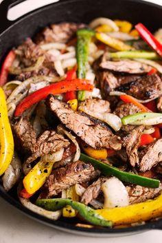 Learn how to make the best steak fajitas! My steak fajitas use one secret ingredient that makes them extra tender and delicious! Best Steak Fajitas, Beef Fajitas, Beef Fajita Recipe, Flank Steak Fajita Marinade, Healthy Fajitas, Steak Tacos, Chicken Fajitas, Mexican Dishes, Italian Recipes