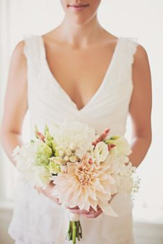A mix of pale peach and white with a dahlia in the center. So feminine and pretty.