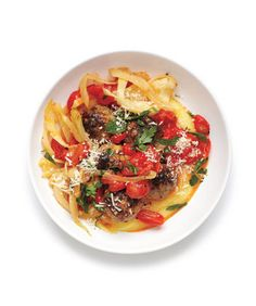 Meatballs With Fennel and Polenta: Cooked until they burst, grape tomatoes provide a pop of color and juicy sweetness to this dish.