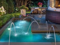 Decorative jets of water add a playful element to this unique L-shaped plunge pool with Bluestone decking from Platinum Poolcare .
