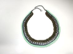 Crochet necklace in taupe, grey and mint.