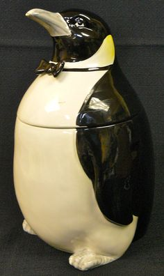 Penguin cookie jar I bought one for my first apartment which was all black & white with a pop of Red!