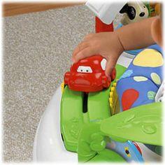 Com o Centro de Atividades Fisher   Price, seu bebê brinca e se desenvolve.