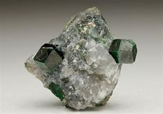 A classic specimen of deep emerald green Uvarovite Garnet from the Outokumpu Orefield, Finland.  Crystal Classics Minerals