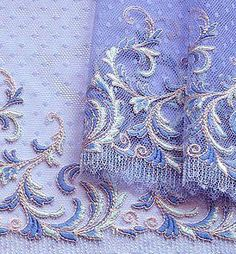 Embroidery on periwinkle
