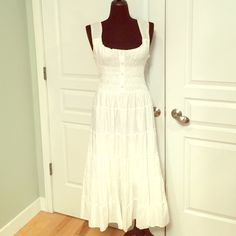 NWT WHITE BOHO MAXI DRESS The tag on the dress says large but it runs more like an XL so I tagged it as an extra large. Dress has stretchy smocking on the top and the bottom is fully lined.  It is 100% cotton. Speed Control Dresses Maxi