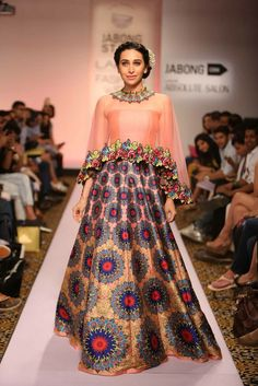 This ethereal cape-style lehenga is perfect for a cocktail or sangeet ceremony!