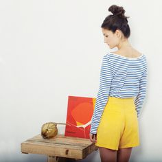 Loreak Mendian S/S '13. Blue and white striped shirt and high waist yellow shorts.