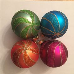 Multi-Colored Ball Ornaments | glass - 2 5/8 in. | 7 ornaments (minus 1 orange) | Bought at Walmart | This is my color scheme: turquoise, raspberry pink, lime green, and orange. I think they are a good fit with the Mexican tree.