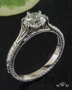 engagement ring disney Six Prong Scroll Engagement RingThis platinum scroll engraved engagement ring features a round brilliant diamond in a 6 prong setting that is intertwined with filigree curls. Platinum Engagement Rings, Antique Engagement Rings, Filigree Engagement Ring, Solitaire Engagement, Ring Set, Ring Verlobung, Bling Bling, Men's Jewelry, Fine Jewelry