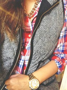 Fall layers: herringbone puffer vest over a red plaid button down.