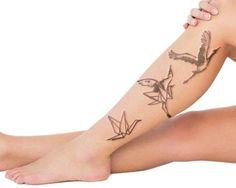 crane tattoo on shin