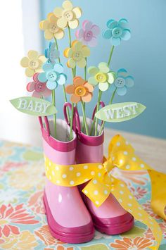Not a link but i like the idea. Baby Shower table decor created by Lisa Storms. Use dollar store shoes.