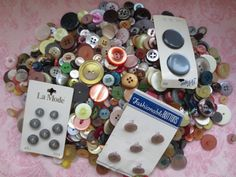 Vintage assorted size and color plastic pearlized buttons. Lot of 850 buttons.