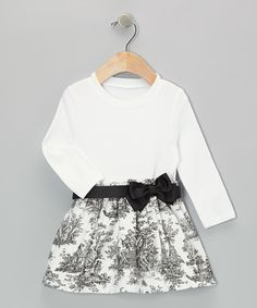 With a transcendent toile pattern and bow accent at the waist, this peppy piece comes with a stretchy tee-style bodice for all-day comfort.100% cottonMachine wash; tumble dryImported