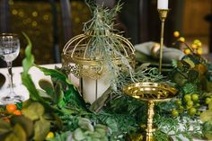 Www.clevents.ca  #chantillylaceevents #cldesigns #fallwedding#falltheme #tablescape #mixandmatch #vintage #bronze #greenery #champagne #swag #tablescape #greeneryswag #candles#birdcage #gold