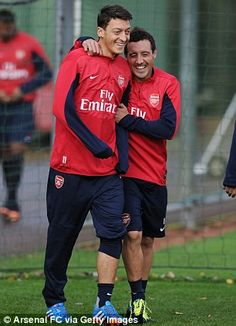Gunner stunner: Ozil - in training today (right) - has taken the Premier League by storm since his arrival from Spain