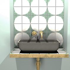 concrete sink with green and white tiles