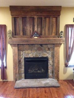 Barnwood mantel from reclaimed barn wood timbers. Veneer stone surround with precast stone hearth