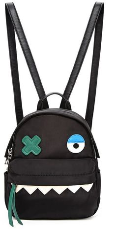 FOREVER 21 Monster Face Mini Backpack - A mini backpack with a faux leather monster face design, a zippered top closure, a top handle, two adjustable shoulder straps, two side patch pockets, and a front zippered pocket.