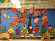 Christian fall bulletin board. The leaves were cut ahead of time, let children draw the veins of the leaves with black marker and then water color over it with red and orange.