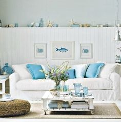 Aqua and white coastal living room... from House to Home. Featured on Completely Coastal: http://www.completely-coastal.com/2017/07/neutral-coastal-living-room-house-to-home.html