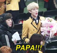 Oh Sehun in a adorable school uniform, with dashing blonde hair, and holding flowers while calling out to his father. How much more adorable can he get?