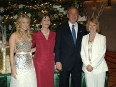 Carrie Underwood poses for a picture with Laura Bush, President George W. Bush and her mother on Dec. 11, 2005 at TNT's Christmas in Washington.