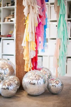 Giant paper tassels and an array of different size disco balls