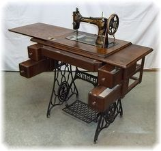 Singer Treadle Sewing Machine - my grandmother had one like this and I have fond memories of it.