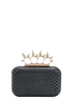 Gold-plated hardware, a scaly skin motif, and tough-luxe rings take this clutch to whole new levels of chic. Snap closure with textured, reptile-print exterior.