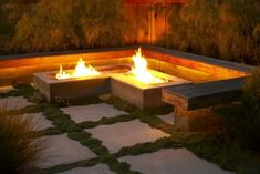 concrete fire pit, wood benches, mossy pavers