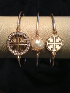 Tory Burch bangle bracelets.