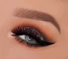 dark brown lid + multicolor glitter, blended into warm orange, pop of green on the waterline + a winged liner make a perfect fall smokey eye | makeup @champagnewhisper