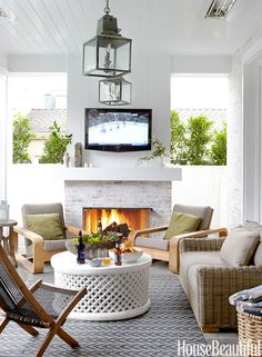 Indoor-outdoor living is made even easier with a television outside, like in this Hermosa Beach, California, house designed by Parrish Chilcoat and Joe Lucas. A fireplace and overhead heat lamps make it possible to entertain on the loggia year-round.   - HouseBeautiful.com