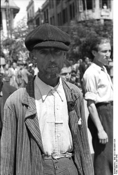 Thessaloniki, Greece, July 1942: A Jewish man awaits registration for hard labor. Those who appeared for registration were forced to wait for hours under a scorching sun while all the while being harassed, beaten, and made to perform calisthenics by the Germans.