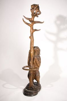 Amazing Black Forest Hall Tree. Hand carved...Kitty is up a tree because the dog chased her up there!  How could you not smile when you look at this. Photo via Google Search.  Daniels Antiques • 431 East Hyman Avenue, Aspen, CO 81611 • Ph: 970-544-9282 • Email: danielsantiques@comcast.net
