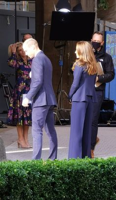 Kate made a quick change of attire for this later engagement, sporting a vibrant blue two-...