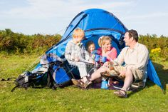 Family camping with tent cooking Royalty Free Stock Photo