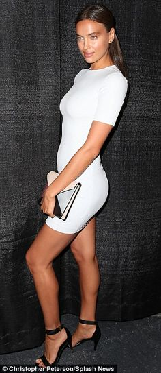 Beach bunnies: Russian model Irina Shayk wowed in a tight white dress and Chrissy Teigen sent temperatures soaring as they attended Mercedes-Benz Fashion Week in Miami on Friday