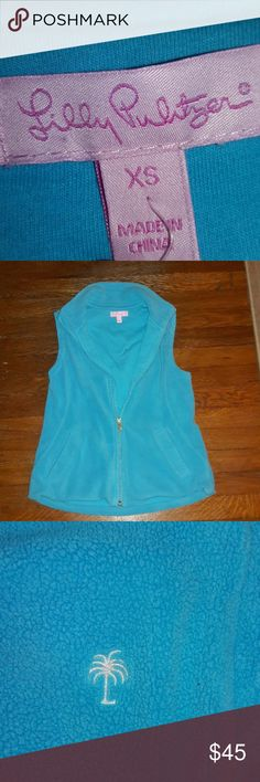 🌼☃️Lilly Pulitzer Fleece Vest☃️🌼 🌼This is my Crazy Daisy Pick🌼  NWOT, unfortunately the tag came off in storage. I'm always cold so I need sleeves 😂😂😂 Never worn. Beautiful turquoise color. All fabric info in the last picture. Lilly Pulitzer Jackets & Coats Vests