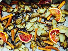 {Part of Dinner Mar 24} Baked fingerling potatoes, blood oranges and carrots, sprinkled with cinnamon, salt and pepper. Feeling enticed