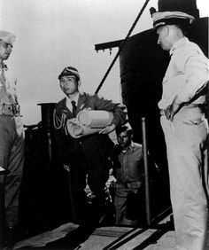 A Japanese naval officer with charts of Sagami and Tokyo Bays arrived aboard Missouri for a conference with Admiral William Halsey's staff, 27 Aug 1945.