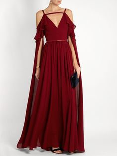Elie Saab Crimson Flounce-Trimmed Silk Chiffon Gown. This Gown Demands to go Lavish. It has a Complex Bodice, Fitted with Flounced Cold Shoulders and Slit Sleeves that Reach the Floor. The Skirt is Full and Floor-Length. It has a distinctly Medieval Feel about it, so I replaced the Self Belt with a Snake Chain Belt. I've got a Byzantine Color Palette with Emeralds & Rubies. A Multi-Colored Silk Cloak and Black Suede Laced Boots & Bag Finish (It's all on this board). Voluptuous! - Gabrielle