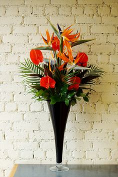 A few photos of the vibrant corporate flower vases being delivered this morning, with coral anthuriums, sunflowers and bird of paradise. What do you think? #reidsflorists #corporateflowers #tropicalflowers