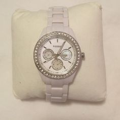 Fossil Watch in White with Rhinestones Super cute everyday watch from Fossil! Expandable open/closure. The face has some minor scratches, hardly noticeable. The battery is out but can be replaced for $10-15 at a neighborhood jeweler/watch repair store. Fossil Accessories Watches