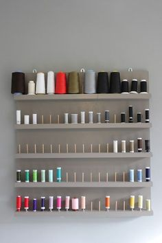 colorful thread storage on a neutral background. very elegant!