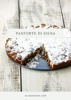 Panforte di Siena recipe - a medieval Italian cake made with nuts, spices, candied fruit, honey, then baked until firm and dusted with confectioner's sugar.