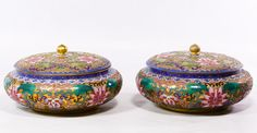 Lot 442: Asian Cloisonne Lidded Jars; Pair of squat, round jars with gilt painted ground and stylized floral motifs